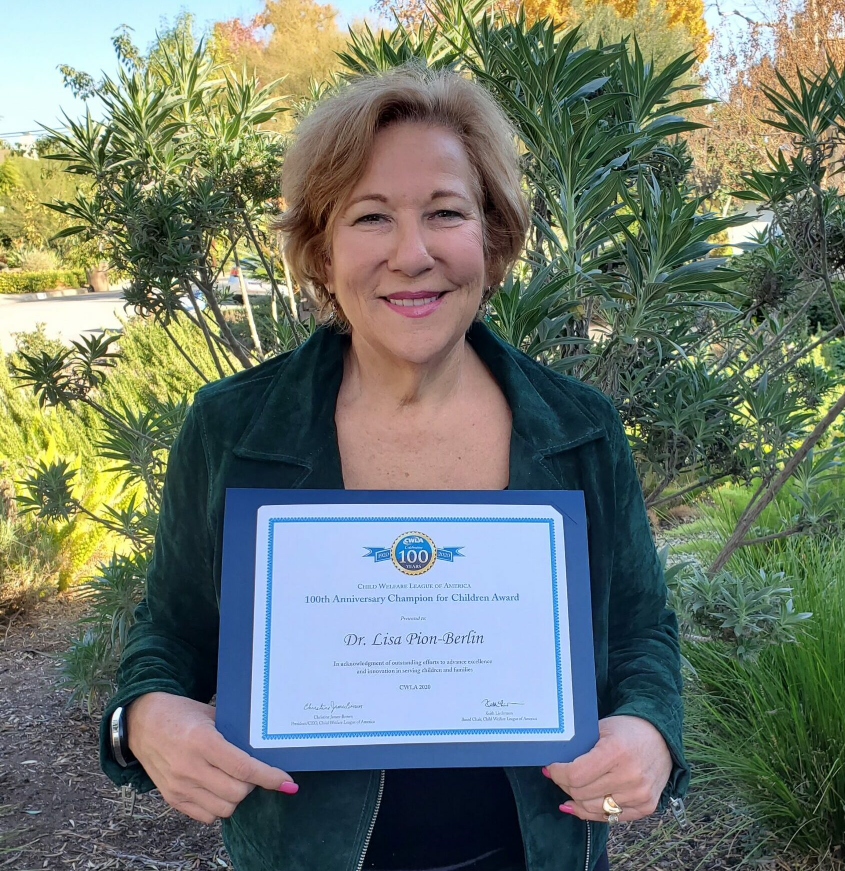 Congratulations to Dr. Lisa, President and C.E.O of Parents Anonymous® for receiving the 100th Anniversary Dr. Lisa holding Champion for Children Award from Child Welfare League of America