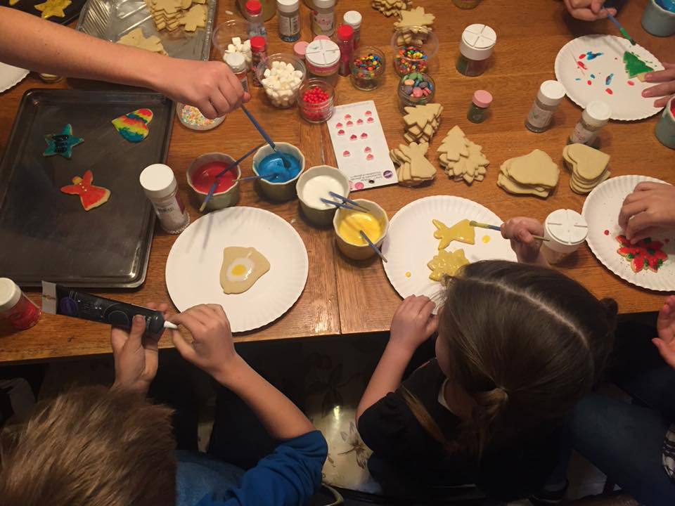 Children decorating holiday cookies